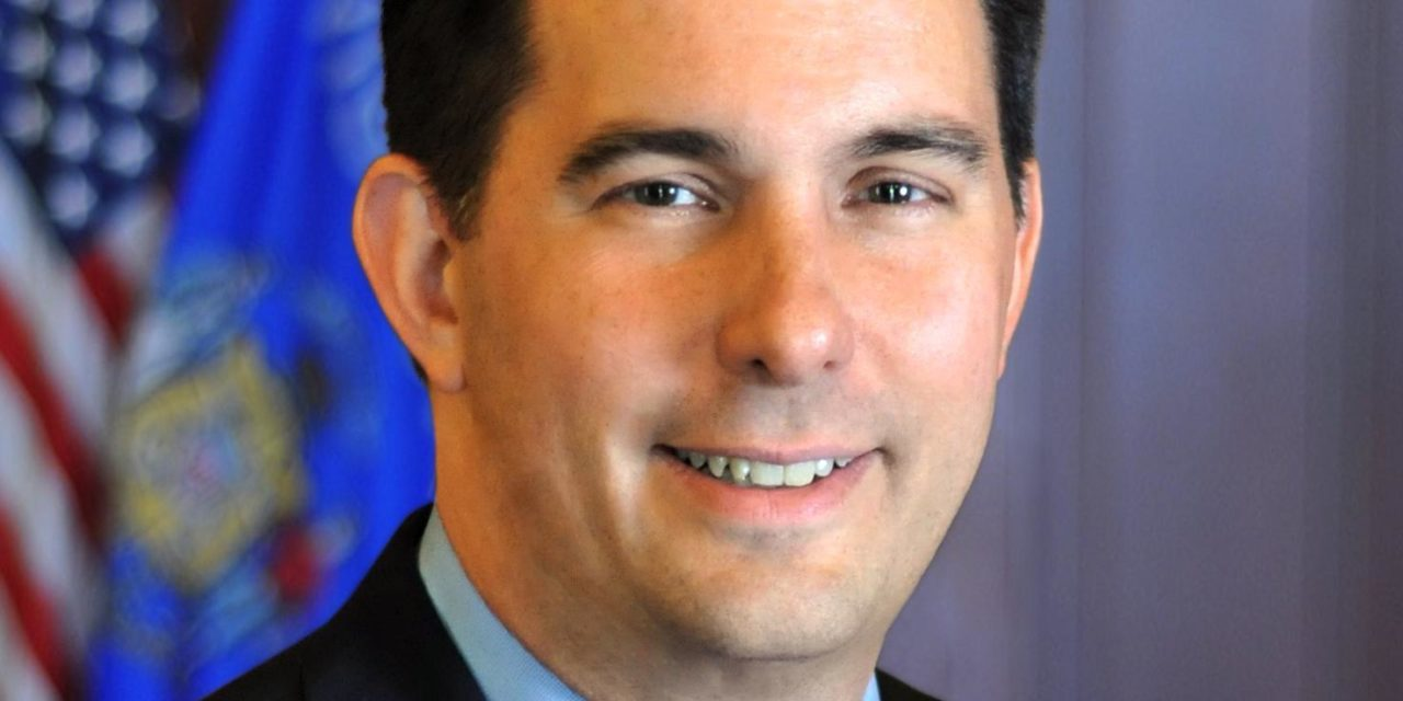 Walker wants federal pre-existing condition protections in state law